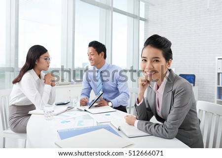 Portrait of young Vietnamese business lady at the meeting