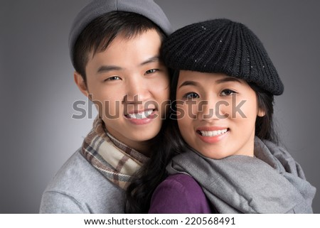 Portrait of young Vietnamese couple in warm clothes - stock photo
