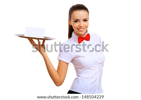 Portrait of young waitress with an empty tray - stock photo