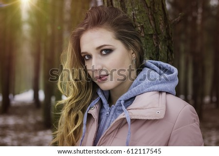 Portrait of young walking woman in forest