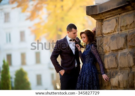 portrait of young wedding couple, looking at each other - stock photo