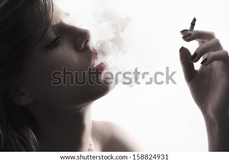 Portrait of young with cigarette - stock photo