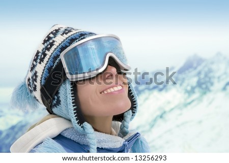 Portrait of young woman against a background of the mountains - stock photo