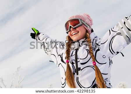 Portrait of young woman against a background of the winter sky - stock photo