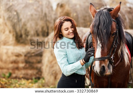 Portrait of Young woman and brown Horse