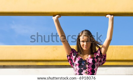 Portrait of young woman at industrial area. - stock photo