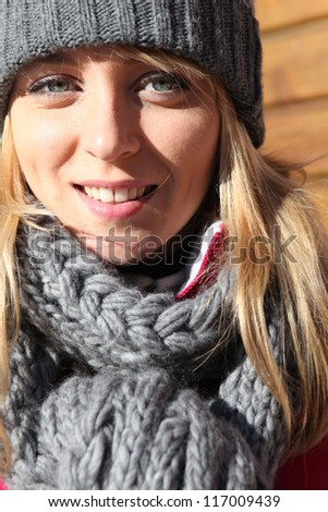 portrait of young woman at ski resort - stock photo