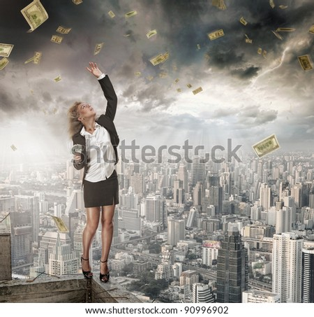 portrait of young woman catching money on color background
