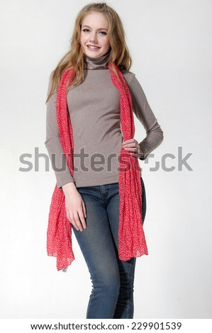 Portrait of young woman cheerful in scarf posing  - stock photo