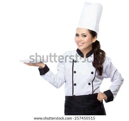 Portrait of young woman chef showing blank area for sign or copyspase - stock photo