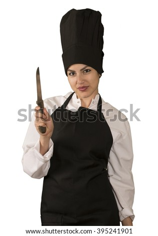 Portrait of young woman chef with a knife isolated
