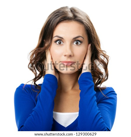 Portrait of young woman covering with hands her ears, isolated over white background - stock photo