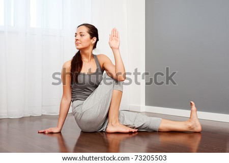 portrait of young woman doing flexibility yoga exercise - stock photo