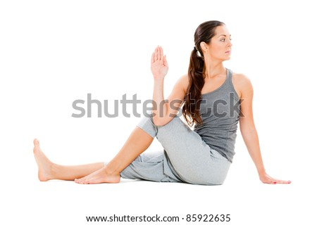 portrait of young woman doing flexibility yoga exercise. isolated on white background - stock photo
