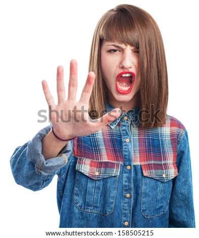 portrait of young woman doing stop symbol gesture - stock photo