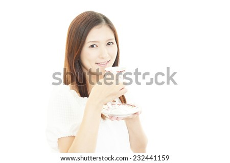 Portrait of young woman drinking cup of coffee. - stock photo