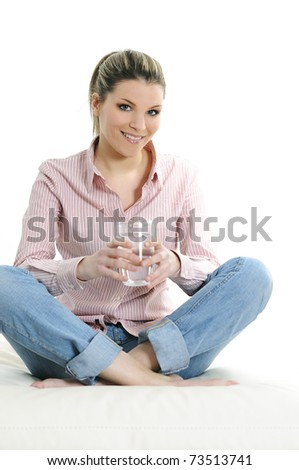Portrait of young woman drinking water - stock photo