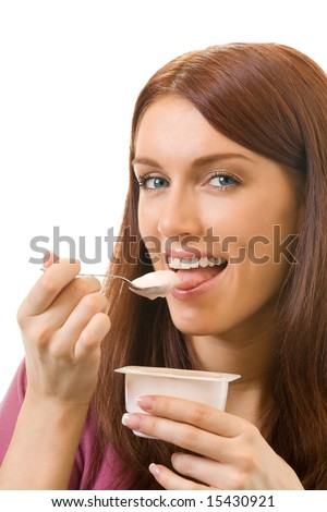 Portrait of young woman eating yogurt, isolated on white