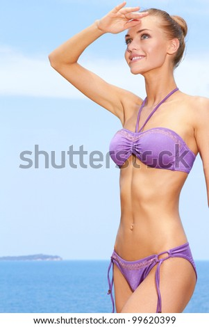 Portrait of young woman enjoying outdoors at the beach