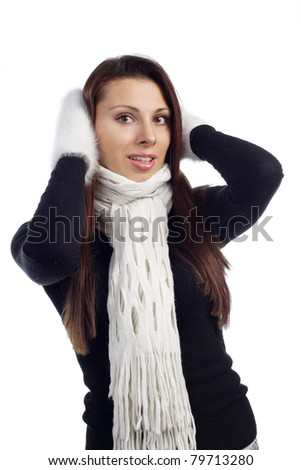portrait of young woman feeling cold with wollen mitten  scarf and sweater - stock photo