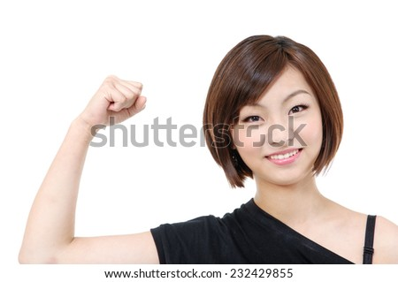 portrait of young woman gesturing victory - stock photo