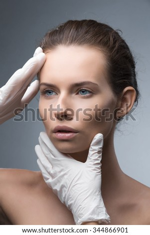 Portrait of young woman getting cosmetic injection. Clean Beauty. Opened eyes.