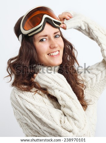 Portrait of young woman go in for winter sports over white background