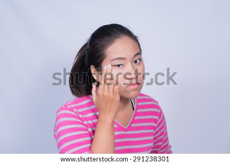 Portrait of young woman having a sore eyes.