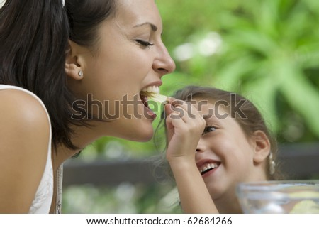 portrait of young woman having good time with her daughter