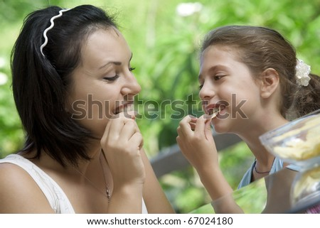 portrait of young woman having good time with her daughter - stock photo