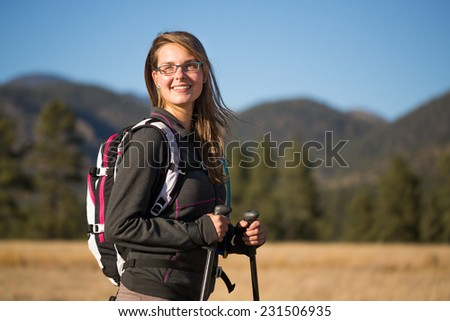 Portrait of Young Woman Hiking and Enjoying the Outdoors - stock photo
