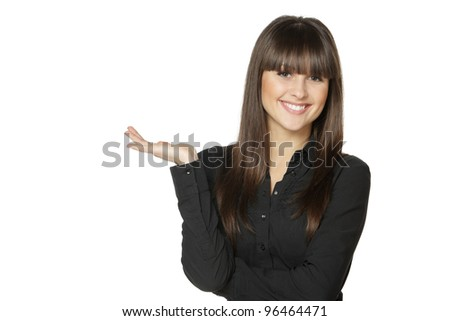 Portrait of young woman holding an empty copy space on the open hand palm, over white background