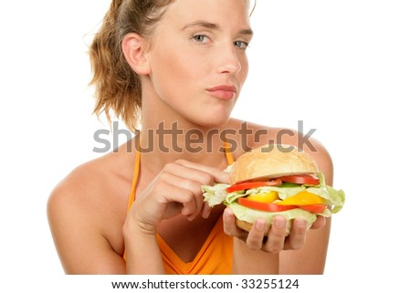 Portrait of young woman holding burger isolated on white background - stock photo
