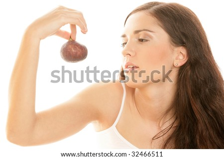 Portrait of young woman holding fig isolated on white background - stock photo