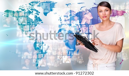 Portrait of young woman holding her tablet computer and communicating with her friends across the world. Standing against world map with photo of people. International communications concept - stock photo