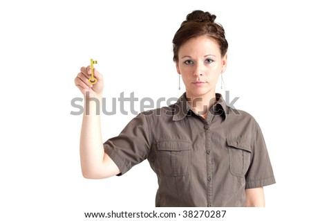 Portrait of young woman holding the golden key. Isolated over white background.