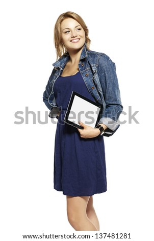 Portrait of young woman holding touchpad tablet - stock photo