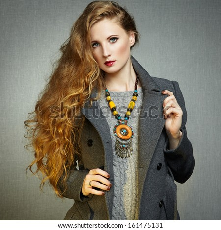 Portrait of young woman in autumn coat. Fashion photo - stock photo