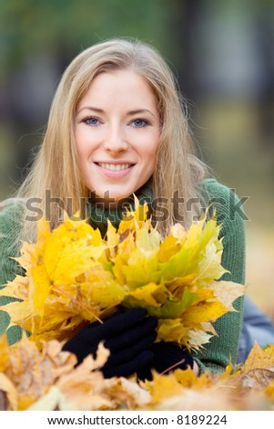 portrait of young woman in autumnal park - stock photo
