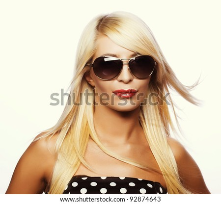 Portrait of young woman in big sunglasses