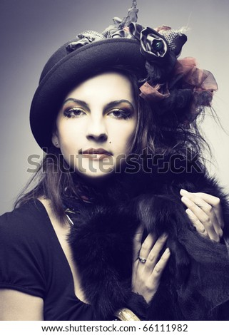 Portrait of young woman in creative image and in vintage hat. - stock photo