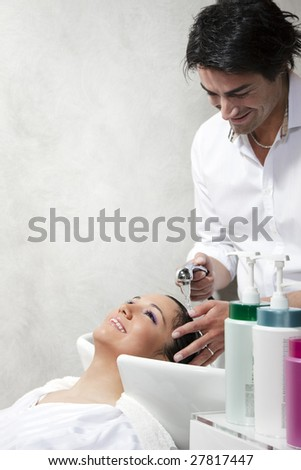 portrait of young woman in hair salon. Copy space - stock photo