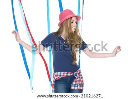portrait of young woman in jeans with color ribbons posing