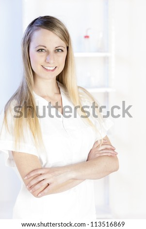 portrait of young woman in laboratory - stock photo