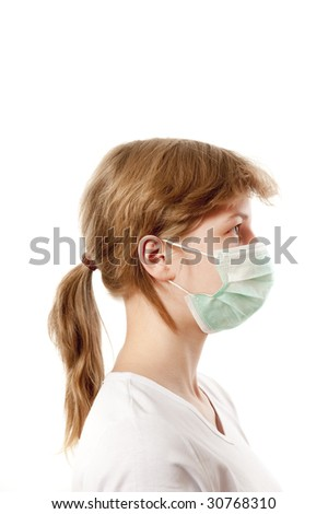 Portrait of young  woman in respirator against white background - stock photo