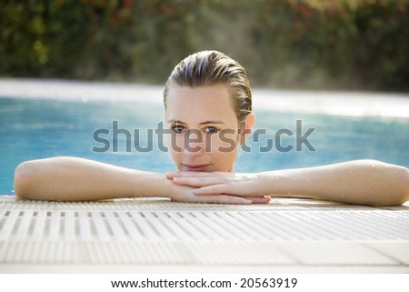 Portrait of young woman in spa, front view - stock photo
