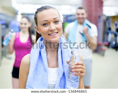 portrait of  young woman in sport gym - stock photo