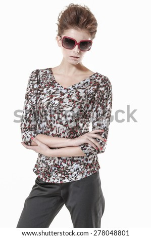 Portrait of Young Woman in sunglasses Standing posing - stock photo