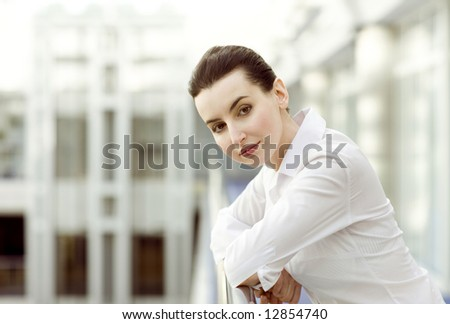 Portrait of young woman in white shirt - stock photo