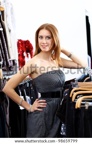 Portrait of young woman inside a store buying clothes